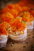 Spicy canapés made with bread, egg, mayonnaise cream and carrots