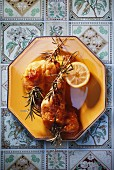 Chicken legs with rosemary and lemons