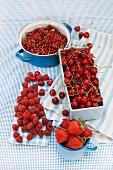 An arrangement of red berries and cherries