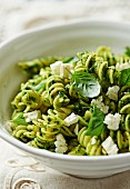 Fusilli in salsa verde, goat's cheese and basil (close-up)