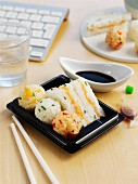 Sushi balls and sushi sandwiches with soy sauce