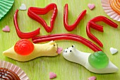The word LOVE and fruit gum snails