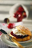 A scone filled with cherry jam and cream cheese