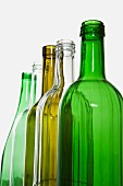 A row of different coloured glass bottles