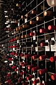 Bottles of wine on a shelf in a cellar