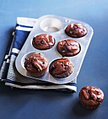 Pecan nut muffins in a muffin tin