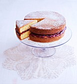 A Victoria Sponge Cake dusted with icing sugar