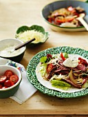 Beef fajitas with sour cream, tomatoes and cheese