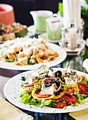 Greek salad with feta cheese on a laid table