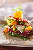 Beef carpaccio with rocket, yellow peppers and Parmesan