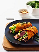 Tomato and pepper wraps with haloumi, roast beef and pine nuts