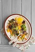 Flash fried pork belly on a mango salad
