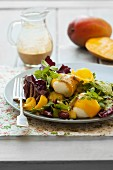 Mozzarella wrapped in mango on a radicchio salad with a curry and coconut dressing