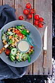 Chickpea salad with tomatoes, cucumber and garlic dressing