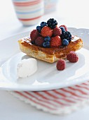A berry tartlet with whipped cream