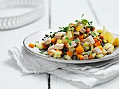 A lentil salad with diced turkey