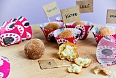 Doughnut balls in colourful paper cases with little name flags