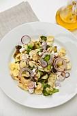 Orecchiette pasta with broccoli and red onions