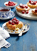 Coconut tartlets with raspberries