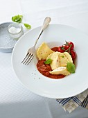 Ravioli with a ricotta filling and a fruit tomato sauce