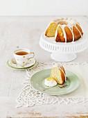 Lemon Bundt cake with icing sugar served with tea