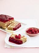 Sliced chocolate and raspberry tiramisu, one slice on a plate