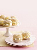 Mini lemon jelly cakes filled with cream and grated coconut