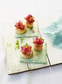 Puff pastry rolls with Serrano ham and beetroot shoots