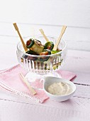 Dates wrapped in courgettes served with a peanut cream dip