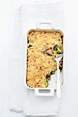 Courgette crumble with ham and mushrooms