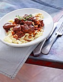 Oxtail ragout with chocolate on a bed of tagliatelle