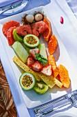 A platter of fresh fruits outside