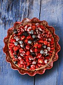 Fruit tart made with red fruits and icing sugar