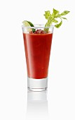 A Bloody Mary garnished with a sprig of salary and wedge of lime