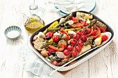 Oven-roasted vegetables: potatoes, tomatoes, courgettes and asparagus