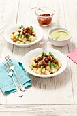 Gnocchi with basil pesto, asparagus and dried tomatoes