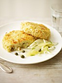 Potato cakes with capers served with a fennel and grapefruit salad