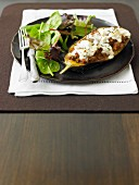 A stuffed aubergine filled with minced lamb, feta and Greek yoghurt