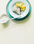 Boiled cod steak with salted potatoes