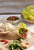 Rice noodles with minced meat in a lettuce leaf