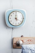 Wall clock in kitchen above towel rack