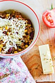 Chilli con carne topped with cheddar cheese