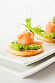 Salmon crostini with mushy peas