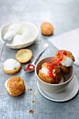 Profiteroles with peach ice cream and cherry sauce