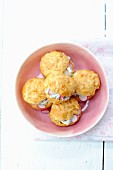 Gougeres with cream cheese and radishes