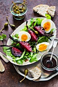 A salad with rockets, Beechwood, boiled eggs and caper fruits