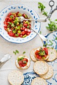 Tomato and kiwi salsa with Greek basil on crackers