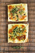 Mozzarella, onion and rosemary pizzas