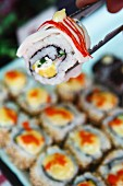 Sushi being sold at a Thai market