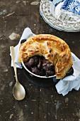Duck pot pie with black cherries